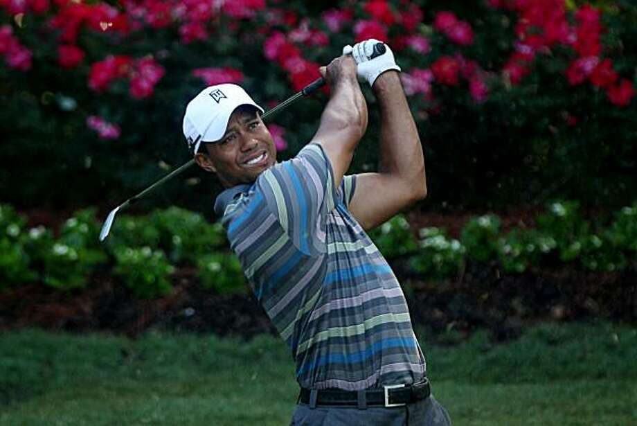 PONTE VEDRA BEACH, FL - MAY 05:  Tiger Woods hits a shot during a practice round prior to the start of THE PLAYERS Championship held at THE PLAYERS Stadium course at TPC Sawgrass on May 5, 2010 in Ponte Vedra Beach, Florida. Photo: Scott Halleran, Getty Images