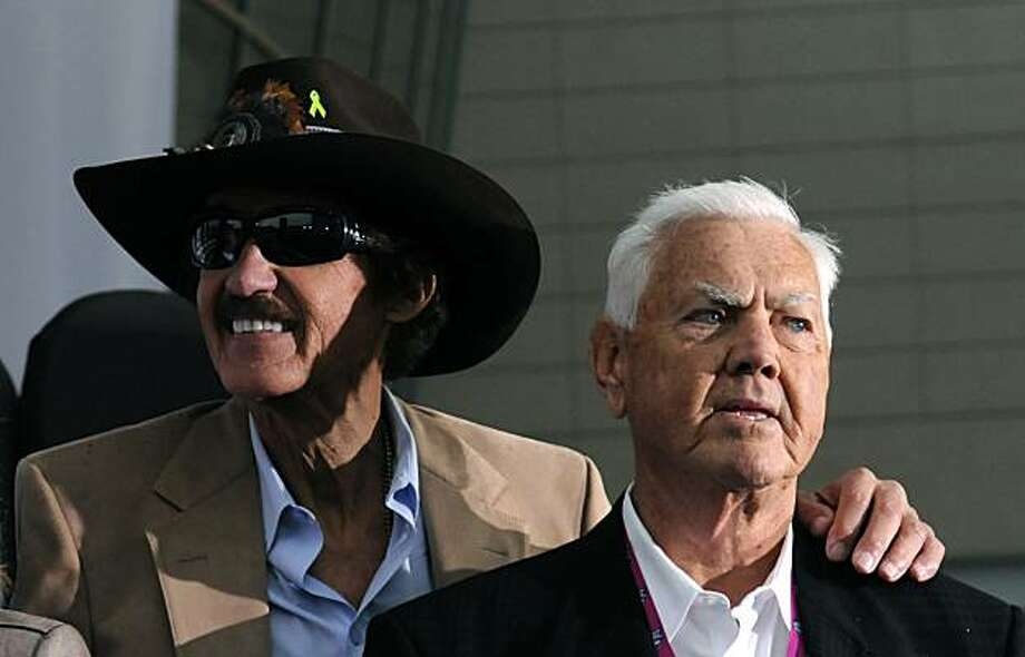Richard Petty, left, and Junior Johnson attend the opening ceremony of the NASCAR Hall of Fame in Charlotte, North Carolina, Tuesday, May 11, 2010. (John D. Simmons/Charlotte Observer/MCT) Photo: John D. Simmons, MCT