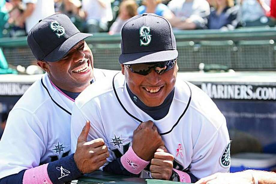 Seattle Mariners' Ken Griffey Jr. greets new batting coach Alonzo Powell prior to the Mariners' game against the Los Angeles Angels on Sunday, May 9, 2010 at Safeco Field in Seattle, Washington. The Mariners won, 8-1. (Mark Harrison/Seattle Times/MCT) Photo: Mark Harrison, MCT