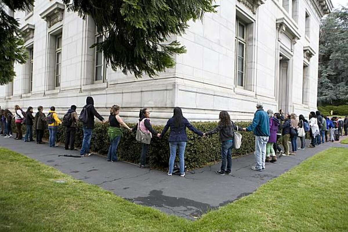 Protesters link arms and surround the building on the 8th day of a hunger strike at California Hall on the UC Berkeley campus in Berkeley, Calif. on Monday, May 10, 2010. Kat Wade / Special to the Chronicle