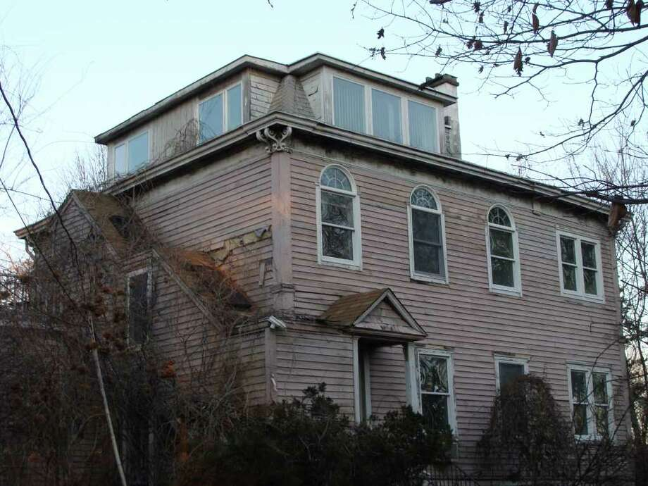 This home at 24 Ludlow Road, dating to 1868, would be razed to make way for a new house of worship proposed by Beit Chaverim Synagogue of Westport/Norwalk. Photo: Meg Barone / Westport News freelance