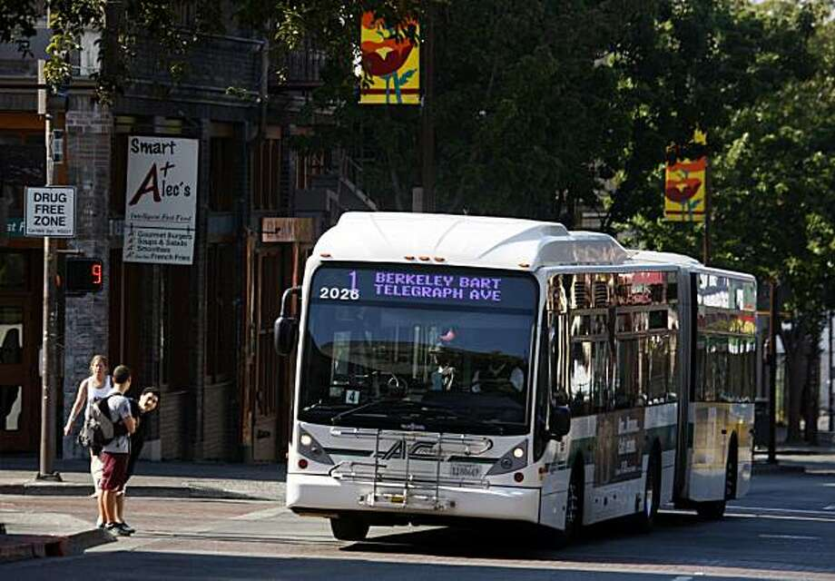 An AC Transit bus rolls down Telegraph Avenue in Berkeley, Calif., on Saturday, July 5, 2008. Berkeley residents may get to vote on a ballot measure which would create a bus-only lane on Telegraph between Dwight Way and Bancroft Avenue. Photo by Paul Chinn / The Chronicle Photo: Paul Chinn, The Chronicle