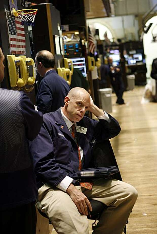 Dennis Leporin watches the monitor on the trading floor of the New York Stock Exchange Tuesday, May 4, 2010, in New York. Stocks plunged around the world Tuesday as fears spread that Europe's attempt to contain Greece's debt crisis would fail. Photo: David Karp, AP
