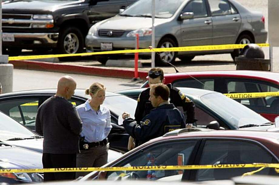 Officials work in a parking lot at Skyline College in San Bruno, Calif. where a shooting occurred on Wednesday, September 2, 2009. Photo: Lea Suzuki, The Chronicle