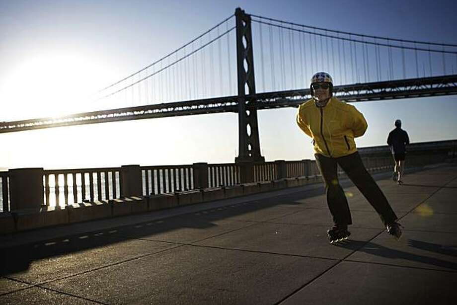 Susie Livingstone, Quality Manager at Gap, Inc., rollerblades along the Embarcadero in her Rollerblade skates and polka dot Nutcase helmet in San Francisco, Calif. on Thursday April 29, 2010. Photo: Lea Suzuki, The Chronicle