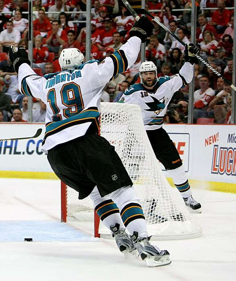 DETROIT - MAY 4:  Patrick Marleau #12 of the San Jose Sharks celebrates his overtime game-winning goal with teammate Joe Thornton #19 who assisted on the goal against the Detroit Red Wings in Game Three of the Western Conference Semifinals during the 2010 Stanley Cup Playoffs at Joe Louis Arena on May 4, 2010 in Detroit, Michigan.(Photo By Dave Sandford/Getty Images) Photo: Dave Sandford, Getty Images