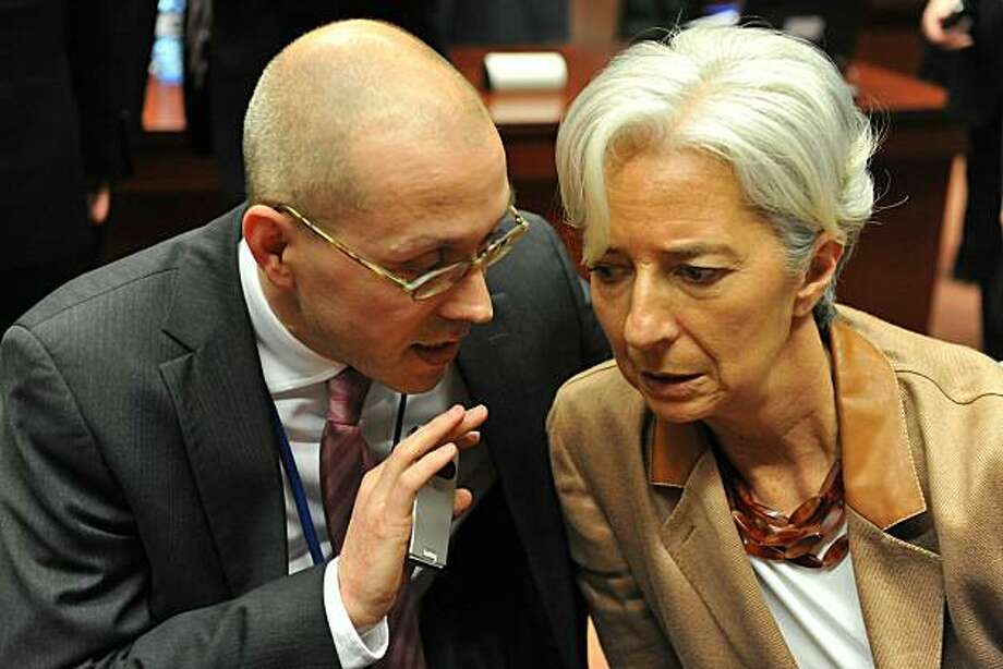French Finance Minister Christine Lagarde (R) listens to German Finance State Secretary Jorg Asmussen before an extraordinary EU Economy and Finance Council meeting on May 9, 2010 at EU headquarters in Brussels. Sources said that ministers were examininga series of elements as part of plans to establish common bailout funds for troubled members hit by a debt crisis triggered in Greece, but which has since spread to other countries. Photo: Georges Gobet, AFP/Getty Images