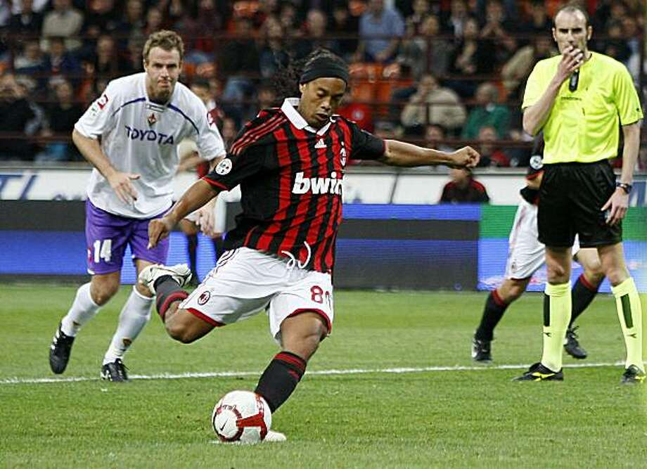 AC Milan Brazilian forward Ronaldinho scores on a penalty kick during the Serie A soccer match between AC Milan and Fiorentina at the San Siro stadium in Milan, Italy, Saturday, May 1, 2010. Photo: Antonio Calanni, AP