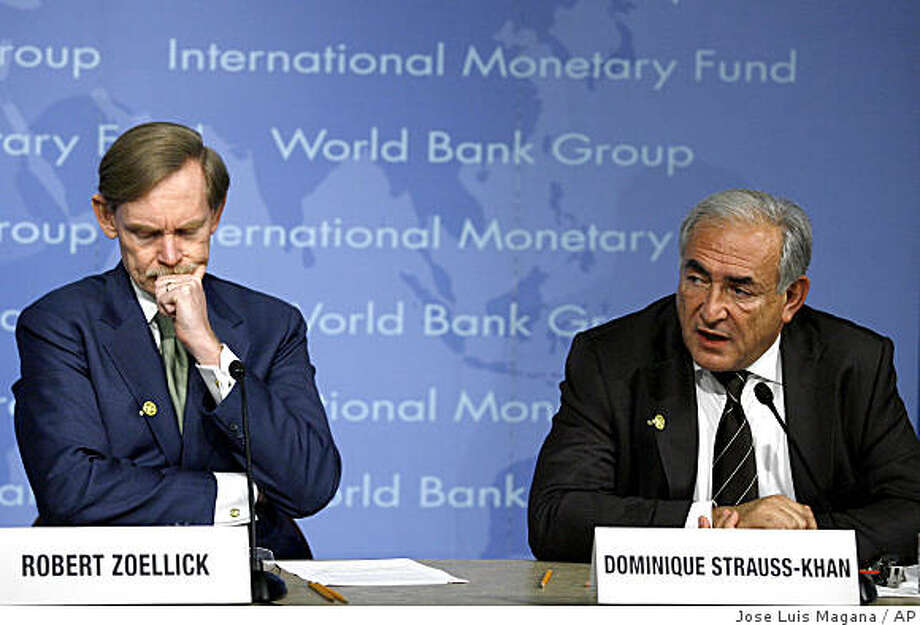 International Monetary Fund Managing Director Dominique Strauss-Kahn, right, and World Bank President Robert B. Zoellick speak during a news conference at IMF headquarters in Washington Sunday, Oct. 12, 2008. The poorest people in the world will be hungrier, weaker and sicker because of the economic slowdown caused by the global financial crisis, and cash-strapped aid agencies will be less able to help them, officials say. The heads of the United Nations, World Bank and International Monetary Fund have each sounded their own warnings about the need to maintain aid giving, but the charities that provide food, medicine and other relief on the ground say cutbacks have already started. (AP Photo/Jose Luis Magana) Photo: Jose Luis Magana, AP