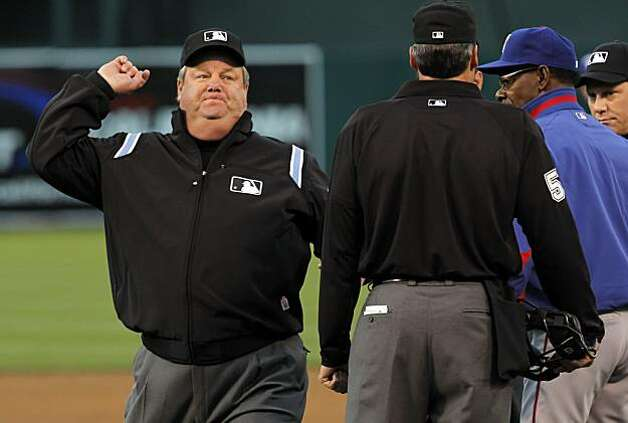 Rangers manager Ron Washington is ejected from the game for arguing a call in the bottom of the second inning in Oakland on Monday. Photo: Carlos Avila Gonzalez, The Chronicle
