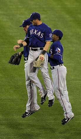 Texas Rangers players celebrate their win in Oakland on Monday. Photo: Carlos Avila Gonzalez, The Chronicle