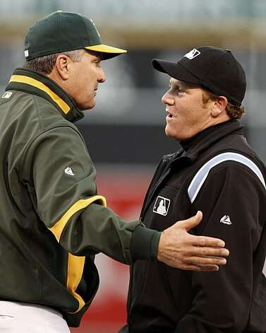Oakland Athletics manager Bob Geren, left, argues a call with first base umpire Paul Schrieber during the second inning of a baseball game Monday, May 3, 2010, in Oakland, Calif. The argument, and the reversal of the original call by Schrieber, resulted in the ejection of Rangers' manager Ron Washington. Photo: Ben Margot, AP