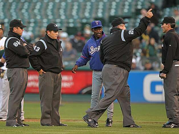 OAKLAND, CA - MAY 03:  Manager Ron Washington of the Texas Rangers is thrown out of the game by umpire Joe West in the second inning against the Oakland Athletics during an MLB game at the Oakland-Alameda County Coliseum on May 3, 2010 in Oakland, California. Photo: Jed Jacobsohn, Getty Images