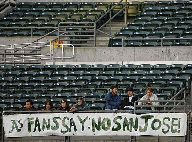 Oakland Athletics fans voice their disapproval of a proposed move by the club to San Jose during the third inning against the Texas Rangers on Monday in Oakland. Photo: Ben Margot, AP