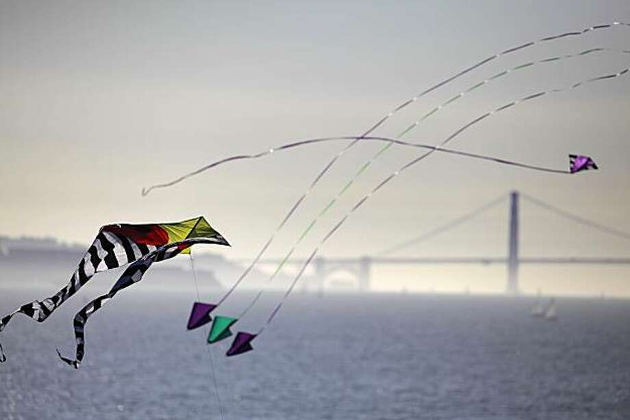 Kites float in front of the view of the Golden Gate Bridge as seen from the Berkeley Marina on Nov. 8, 2009. Photo: Carlos Avila Gonzalez, The Chronicle