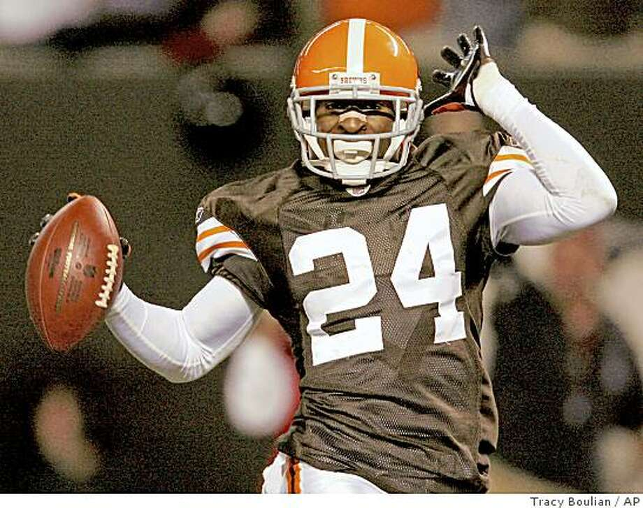 Cleveland Browns cornerback Eric Wright celebrates at the end of his 94-yard interception return for a touchdown Monday, Oct. 13, 2008, against the New York Giants in an NFL football game in Cleveland. Wright idolized Deion Sanders as a kid. He admired Prime Time's flash and skill as the NFL's premier cornerback. On Monday night, Wright got a chance to mimic his hero with a 94-yard interception return for a touchdown that he celebrated by doing Sanders' end zone strut. (AP Photo/The Plain Dealer, Tracy Boulian) Photo: Tracy Boulian, AP