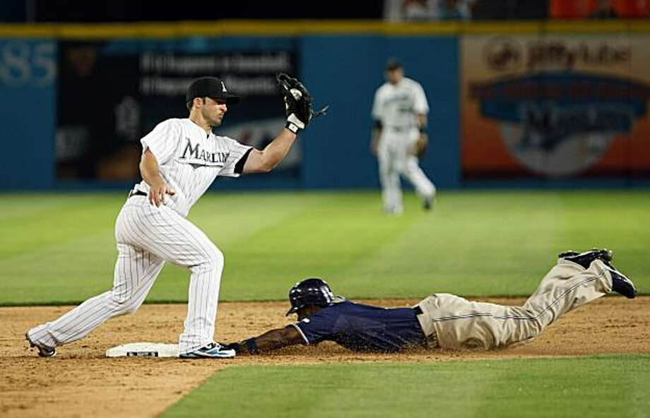San Diego Padres' Tony Gwynn steals second base as Florida Marlins second baseman Dan Uggla attempts the tag during the eighth inning of a baseball game Tuesday, April 27, 2010 in Miami. The Padres defeated the Marlins 4-1. Photo: Wilfredo Lee, AP