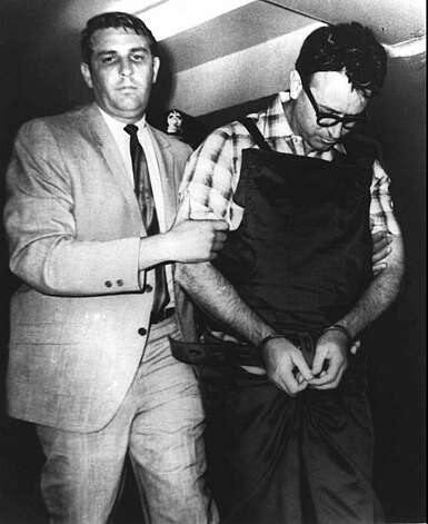 James Earl Ray, handcuffed to a leather belt and wearing a bulletproof vest, is escorted to his jail cell by the Shelby County sheriff, left, in this July 18, 1968 file photo. Ray, the petty criminal who confessed to assassinating Martin Luther King Jr., then recanted and spent decades seeking a trial, died Thursday, April 23, 1998. He was 70. Photo: AP