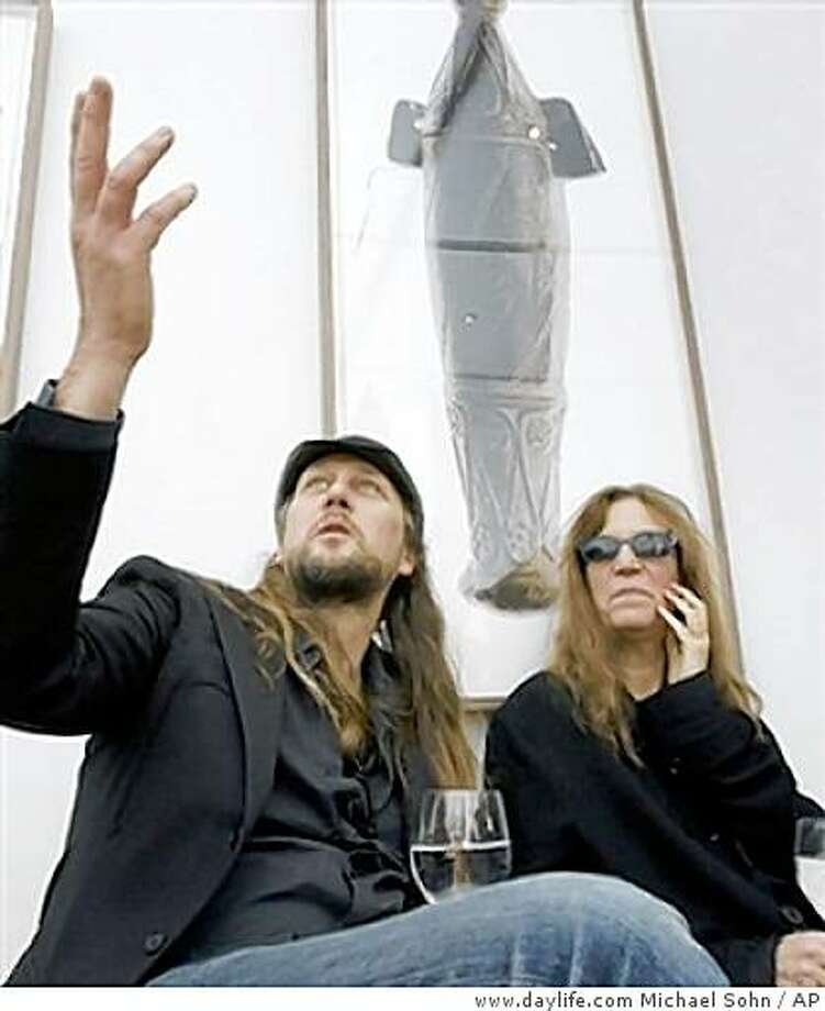 "FIlmmaker/photographer Steven Sebring and Patti Smith in Berlin 2008. He has made the documenary ""Patti Smith: Dream of Life.""US singer Patti Smith, right, and the photographer and artist Steven Sebring, left, are seen during the visit of their multimedia exhibition 'Objects of Life' in Berlin, Germany, Friday, Feb. 8, 2008. Steven Sebring shows his film 'Patti Smith Dream of Life' during the 58th Berlinale film festival which takes place from Feb. 7 to Feb. 17, 2008. (AP Photo/Michael Sohn) Photo: Www.daylife.com Michael Sohn, AP"