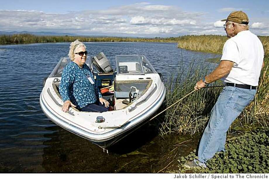 Mary and Dale Glassburn, both 66, of Round Mountain, Calif., put their boat into McArthur Swamp just outside the town of McArthur, Calif., on Thursday, October 2, 2008. The 7,600 acre swamp is owned by the Pacific Gas and Electric company and is one of 47 units of land across California that the company is making available for donation as part of a land conservation project. Photo: Jakob Schiller, Special To The Chronicle