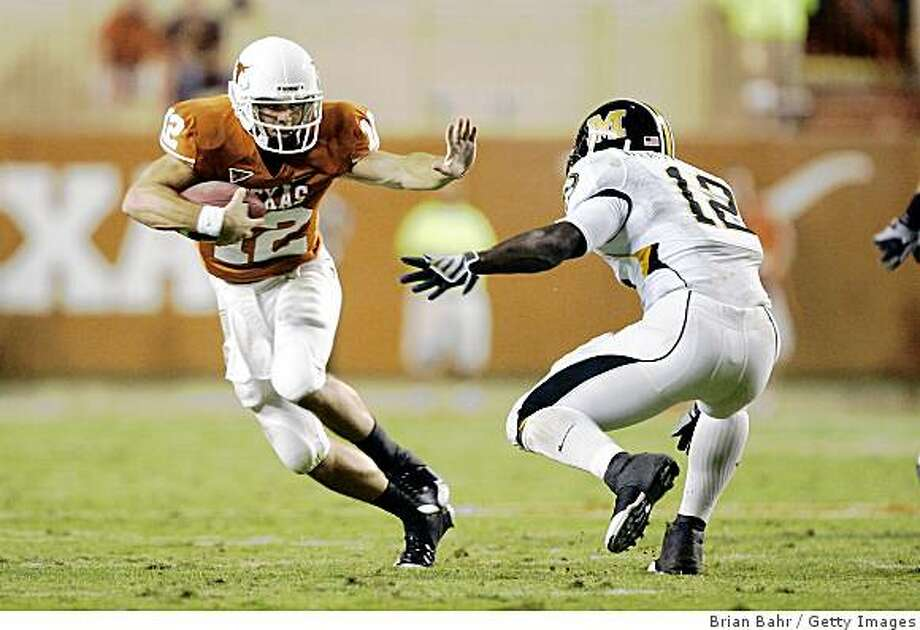 AUSTIN, TX - OCTOBER 18: Quarterback Colt McCoy #12 of the Texas Longhorns dodges linebacker Sean Weatherspoon #12 of the Missouri Tigers in the first quarter on October 18, 2008 at Darrell K Royal-Texas Memorial Stadium in Austin, Texas. (Photo by Brian Bahr/Getty Images) Photo: Getty Images