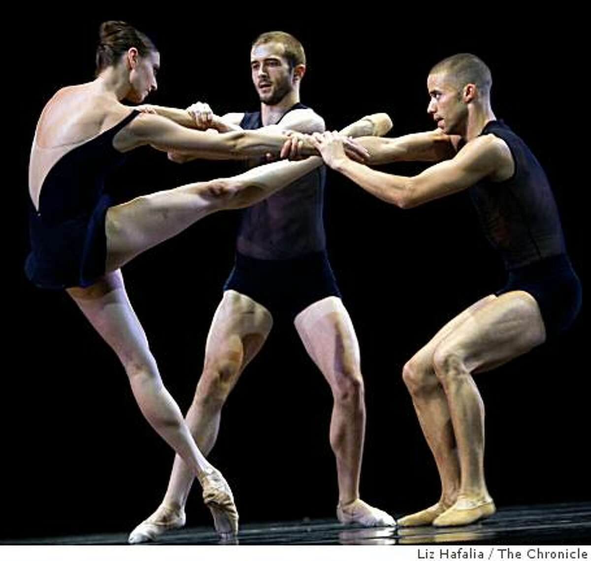 """Ricardo Zayas (R), Meredith Webster (L), and David Harey (middle) performing """"String quartet"""" in the Lines Ballet in a dress rehearsal of the world premiere in San Francisco, Calif., in Yerba Buena Center on Thursday, October 16, 2008."""