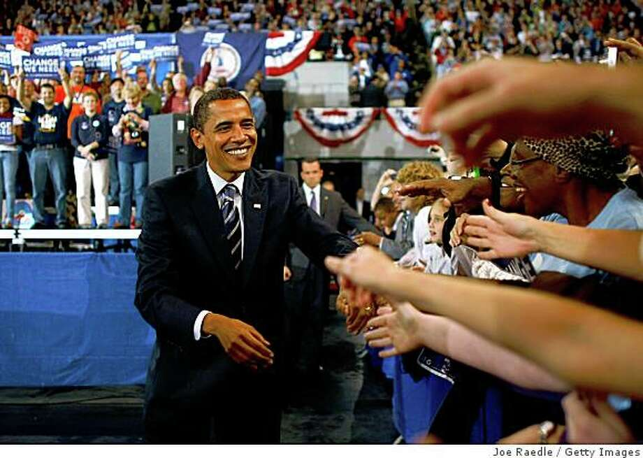 ROANOKE, VA - OCTOBER 17:  Democratic presidential nominee U.S. Sen. Barack Obama (D-IL) shakes hands with people during a campaign event at Roanoke Convention Center October 17, 2008 in Roanoke, Virginia. Obama continues to campaign as Election Day begins to draw near as he runs against his Republican challenger, Sen. John McCain.  (Photo by Joe Raedle/Getty Images) Photo: Joe Raedle, Getty Images