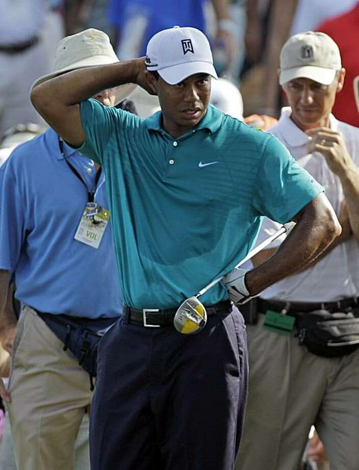 Tiger Woods looks away after an errant tee shot on the 14th hole during the second round of The Players Championship golf tournament, Friday, May 7, 2010, in Ponte Vedra Beach, Fla. Woods shot landed in the middle of a small pond on the 12th fairway. Photo: Chris O'Meara, AP