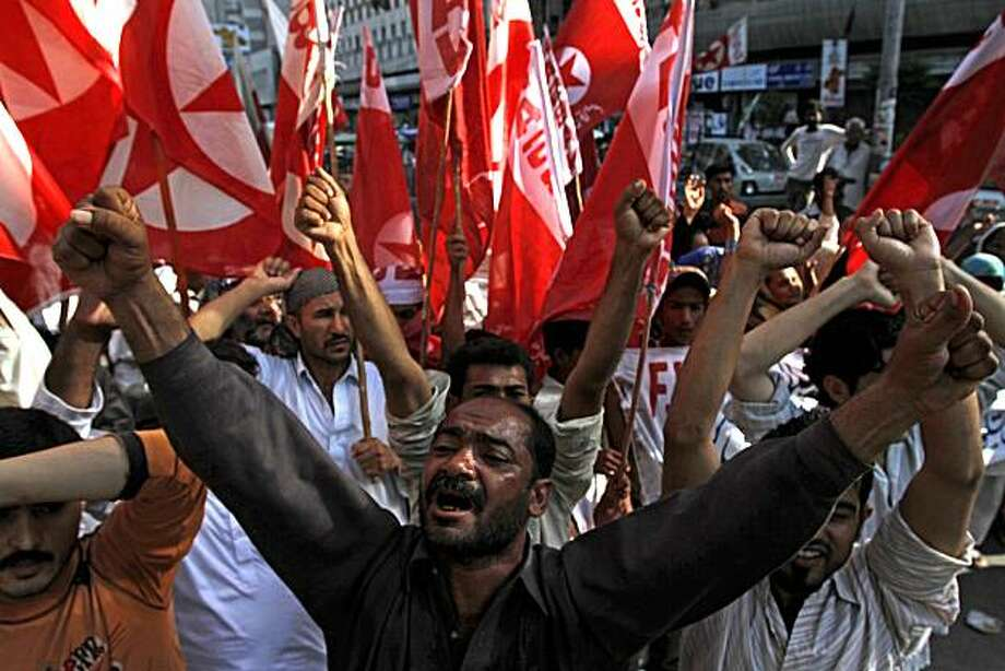 Supporters of the youth wing of Pakistani religious party Jamat-e-Islami rally to support the New York City's Times Square bombing suspect Faisal Shahzad in Karachi, Pakistan on Thursday, May 6, 2010. Pakistani officials say U.S. law enforcement officershave joined them in questioning four alleged members of an al-Qaida-linked militant group over possible links to the Times Square bombing suspect. Photo: Shakil Adil, AP