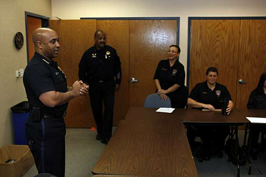 Oakland Police Chief Anthony Batts speaks to dispatchers at the departments dispatch center in Oakland, Calif., on Tuesday, April 27, 2010. After learning that Oakland Police were taking up to 15 minutes to respond to priority calls, Batts revamped the dispatch system, allowing dispatchers the discretion to send officers Code 3 to many more types of calls. Now, police are catching more suspects at the scene of the crime and response times are going down. Photo: Carlos Avila Gonzalez, The Chronicle
