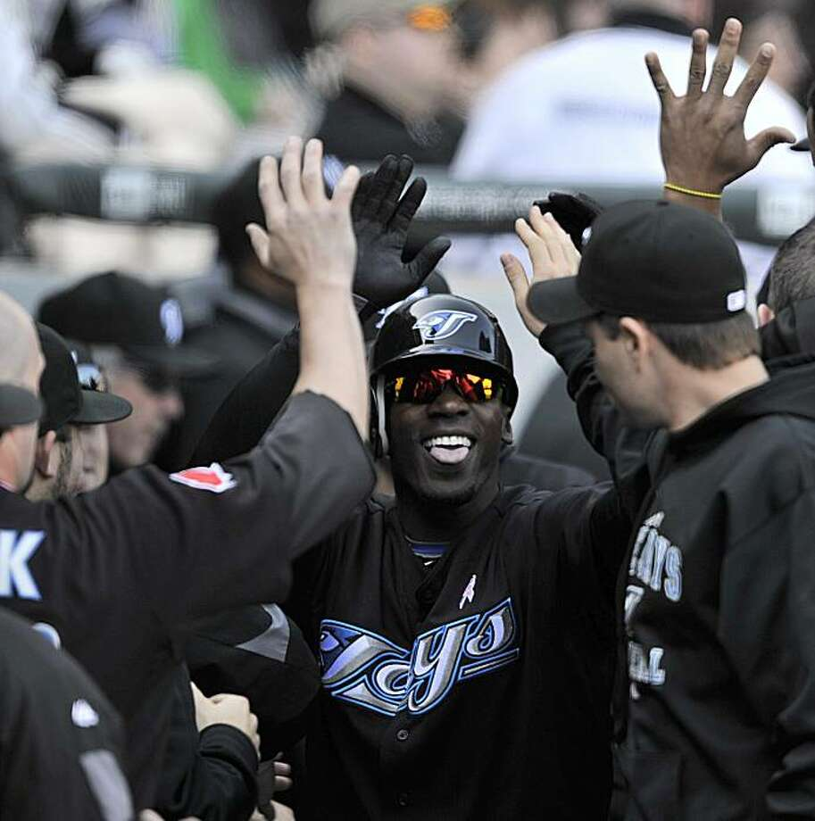 Toronto Blue Jays' Fred Lewis celebrates with teammates after hitting a three run home run against the Chicago White Sox during the ninth inning of a baseball game Sunday, May 9, 2010, in Chicago. Photo: Jim Prisching, AP