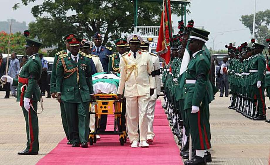 The body of Nigeria's President Umaru Yar'Adua is brought to a plane past an honor guard to be transported for burial in his home state of Katsina, at the airport in Abuja, Nigeria, Thursday, May 6, 2010. Goodluck Jonathan was sworn in Thursday as the president of Nigeria, Africa's most populous nation, just hours after the death of the oil-rich country's elected leader whose long illness had sparked a leadership crisis. Photo: Sunday Alamba, AP