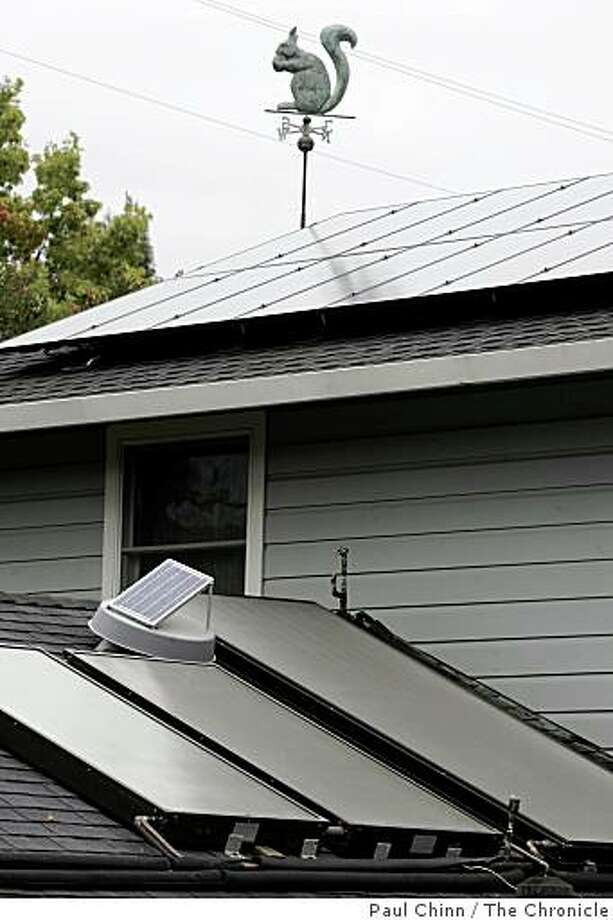 This house has a solar array for power in the home. The small panel at lower left is a solar-powered attic fan for ventilation. Photo: Paul Chinn, The Chronicle