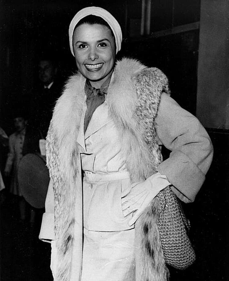 American actress-singer Lena Horne arrives at London's Paddington Station, England, on the Liberte boat-train on April 12, 1956. (AP Photo) Photo: AP