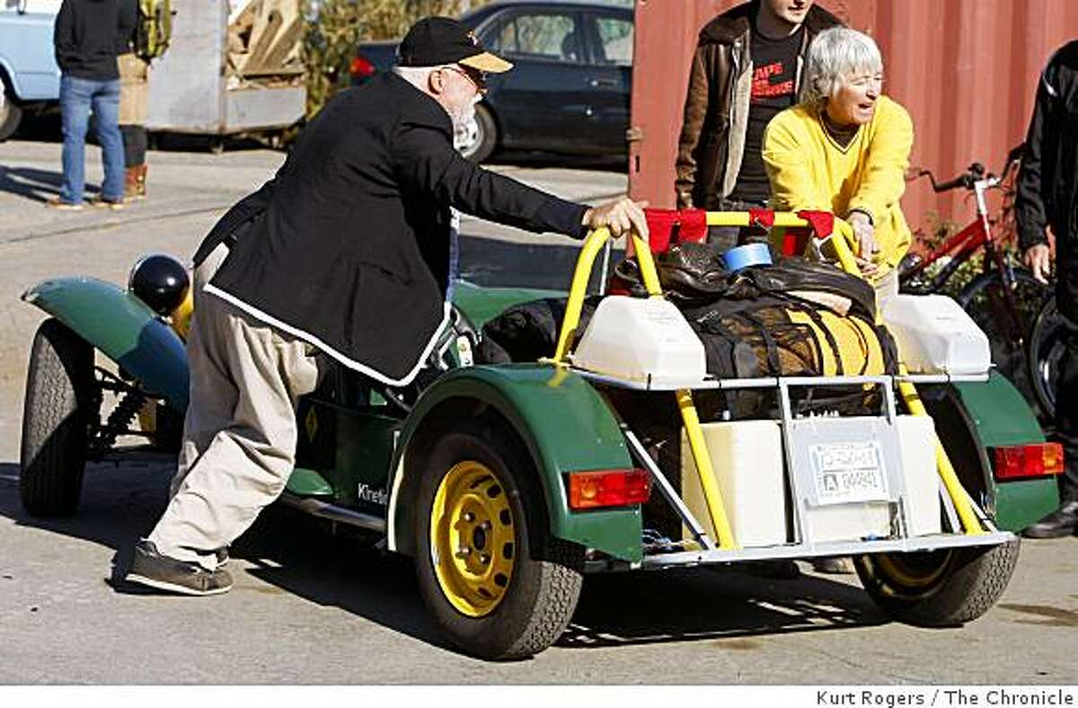 Jack McCornack and Sharon Westcott, of Cave Junction, Ore., back their canola oil-powered Lotus Seven roadster on Saturday, October 11, 2008 into the yard at Shipyard Labs in Berkeley, Calif., for the start of the Escape from Berkeley race.