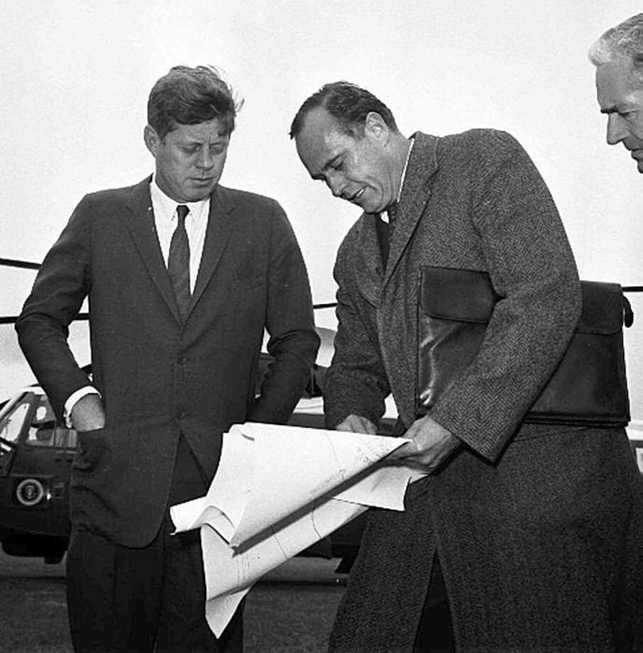 FILE - In this May 11, 1963 file photo, President John F. Kennedy, left, discusses drawings with Washington architect John Warnecke as they look over a possible site for a library to house his public papers near Harvard University in Cambridge, Mass.  Warnecke, the architect who designed President John F. Kennedy's grave site at Arlington National Cemetery, has died. He was 91. Warnecke's son, Fred, said his father died on April 17 of complications from pancreatic cancer at his home in Healdsburg, Calif. Photo: AP