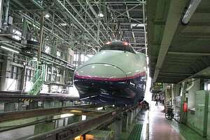 A Shinkansen high-speed train awaits maintenance in the East Japan Railway Rolling Stock Center.