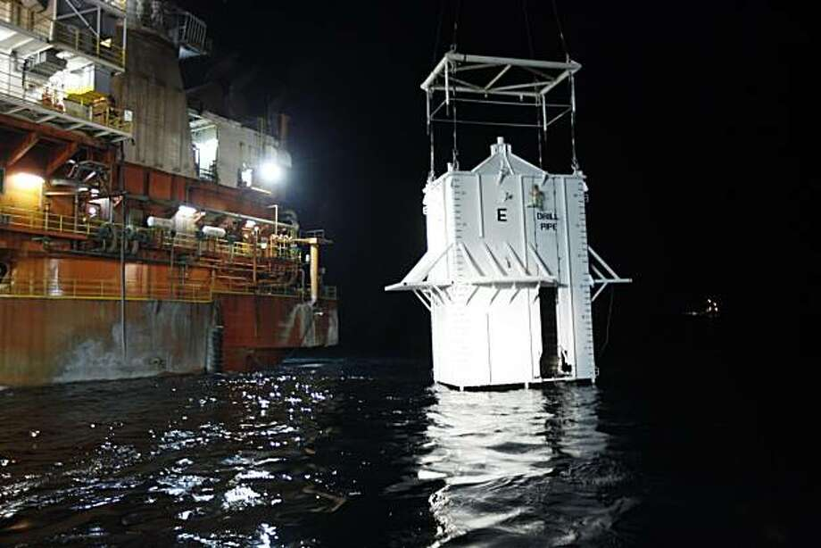The containment  vessel is lowered into the Gulf of Mexico at the site of the Deepwater Horizon rig collapse, Thursday, May 6, 2010. Photo: Gerald Herbert, AP