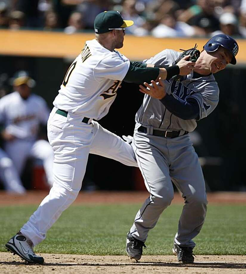 Tampa Bay Rays' John Jaso, right, is tagged out by Oakland Athletics first baseman Daric Barton in a rundown between third base and home plate during the seventh inning of a baseball game Saturday, May 8, 2010, in Oakland, Calif. Photo: Ben Margot, AP