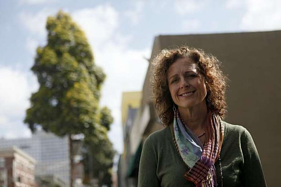 Anne Donnelly, dir. of Health Care Policy at Project Inform, stands for a portrait outside the offices on Mission Street on Wednesday April 14 2010 in San Francisco, Calif. Photo: Mike Kepka, The Chronicle