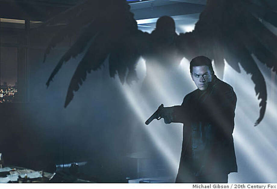 A winged demon becomes an iconic image ? and important clue ? for Max Payne (Mark Wahlberg) as he becomes enveloped in a complex conspiracy. Photo: Michael Gibson, 20th Century Fox