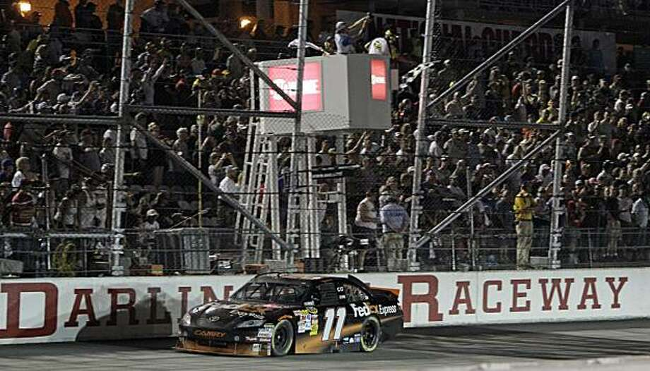 Denny Hamlin (11) crosses the start-finish line to win the NASCAR Sprint Cup Series Showtime Southern 500 auto race at Darlington Raceway in Darlington, S.C., Saturday, May 8, 2010. Photo: Gerry Broome, AP