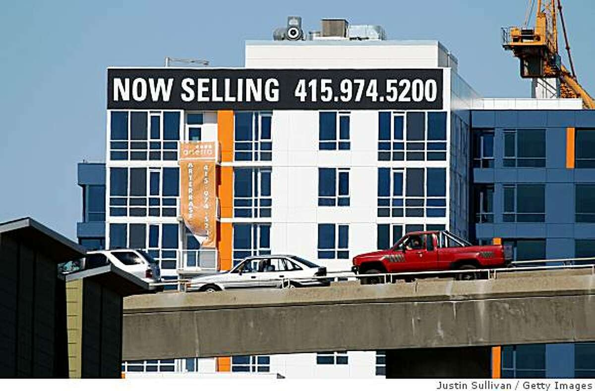 A sign advertising condominiums for sale at a new complex September 2008 in San Francisco. MDA DataQuick says the median home price in Northern California dropped 46 percent in February from a year ago, dropping the figure to its lowest level since 1999.