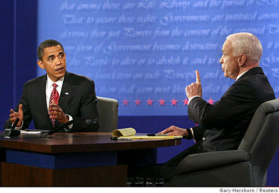 U.S. Democratic presidential nominee Sen. Barack Obama (L) (D-IL) and Republican presidential nominee Sen. John McCain (R) (R-AZ) talk during their presidential debate at Hofstra University in Hempstead, New York, October 15, 2008. Photo: Gary Hershorn, Reuters