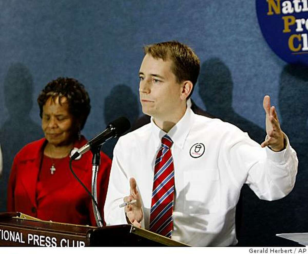 ACORN spokesperson Kevin Whelan speaks at a press conference in Washington, Tuesday, Oct. 14, 2008. Behind him is Maryland ACORN president, Rev. Gloria Swierenga. (AP Photo/Gerald Herbert)