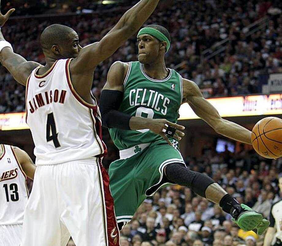 CLEVELAND - MAY 03:  Rajon Rondo #9 of the Boston Celtics looks to pass around Antawn Jamison #4 of the Cleveland Cavaliers during Game Two of the Eastern Conference Semifinals during the 2010 NBA Playoffs at Quicken Loans Arena on May 3, 2010 in Cleveland, Ohio.  NOTE TO USER: User expressly acknowledges and agrees that, by downloading and or using this photograph, User is consenting to the terms and conditions of the Getty Images License Agreement. Photo: Gregory Shamus, Getty Images