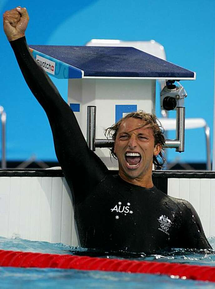 Australia's Ian Thorpe celebrates after winning the gold medal in the men's 200 metres freestyle at the Athens Olympic Games August 16, 2004. Thorpe won in one minute 44.71 seconds. Photo: David Gray, Reuters