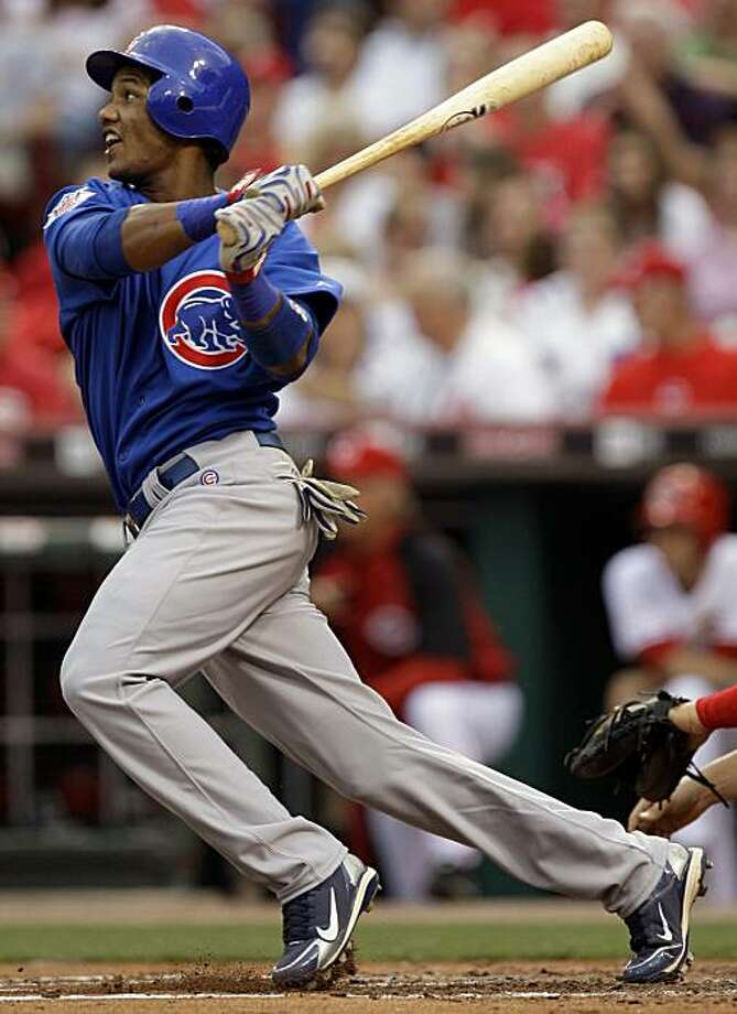 Chicago Cubs' Starlin Castro hits a three-run home run off Cincinnati Reds starting pitcher Homer Bailey in the second inning of a baseball game, Friday, May 7, 2010, in Cincinnati. It was the first major league at-bat for Castro. Photo: Al Behrman, AP