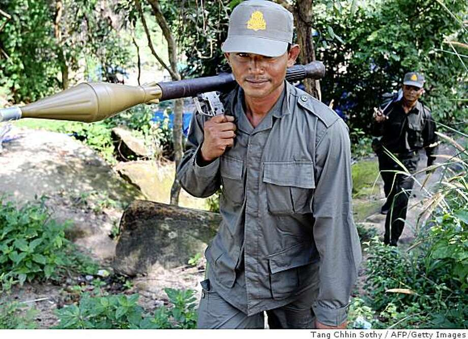 Cambodian soldiers patrol near Preah Vihear temple in Preah Vihear province, some 543 kilometers north of Phnom Penh on October 15, 2008.  Cambodian military officials earlier said that the Thai soldiers had moved out of the contentious area near the ancient Preah Vihear temple, after Cambodian Prime Minister Hun Sen issued an ultimatum. Thailand's foreign minister on October 14, denied that about 80 of the country's troops had withdrawn from a disputed area on the border with Cambodia, and insisted they had the right to stay there.  AFP PHOTO/TANG CHHIN SOTHY (Photo credit should read TANG CHHIN SOTHY/AFP/Getty Images) Photo: Tang Chhin Sothy, AFP/Getty Images