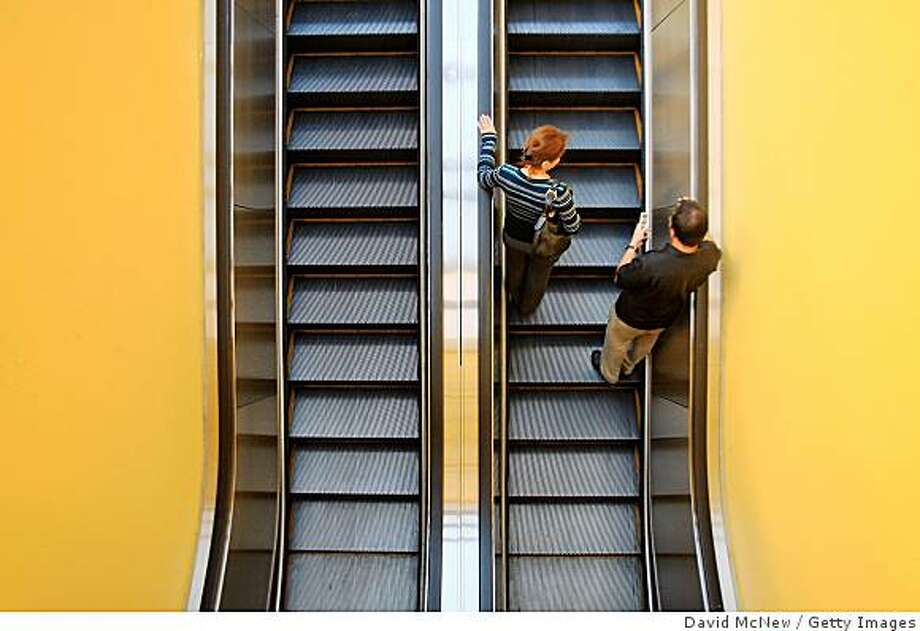 PASADENA, CA - OCTOBER 15:  People ascend an escalator a shopping mall on October 15, 2008 in Pasadena, California. U.S. retail sales in September plummeted by the largest amount in three years, with the Commerce Department reporting that retail sales dropped 1.2 percent, almost twice the 0.7 percent drop that had been expected. It is the biggest decline since August 2005 when retail sales fell 1.4 percent.    (Photo by David McNew/Getty Images) Photo: Getty Images